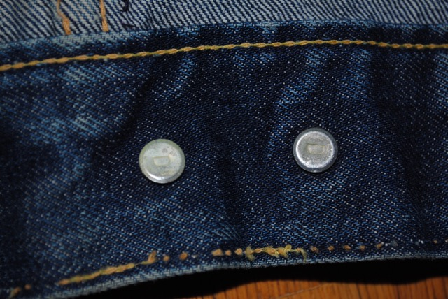 D stamp on waistband button